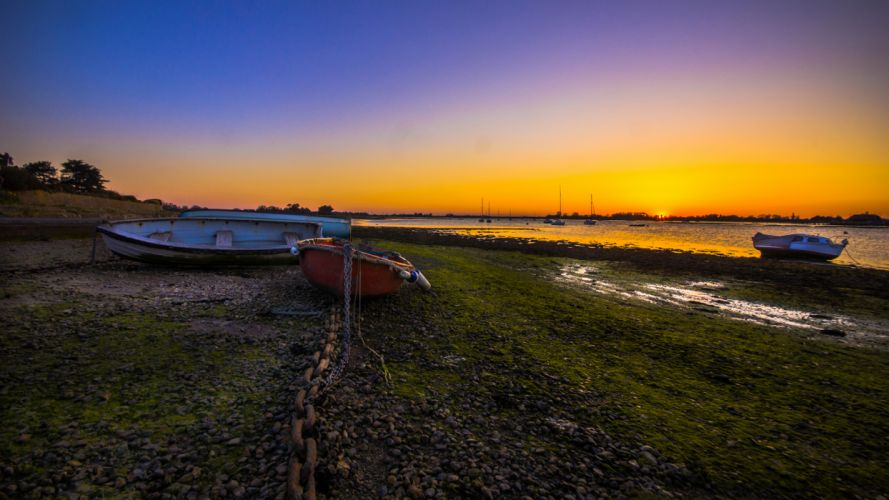 Boats Beached Sunset Chain beaches watercrafts sky wallpaper