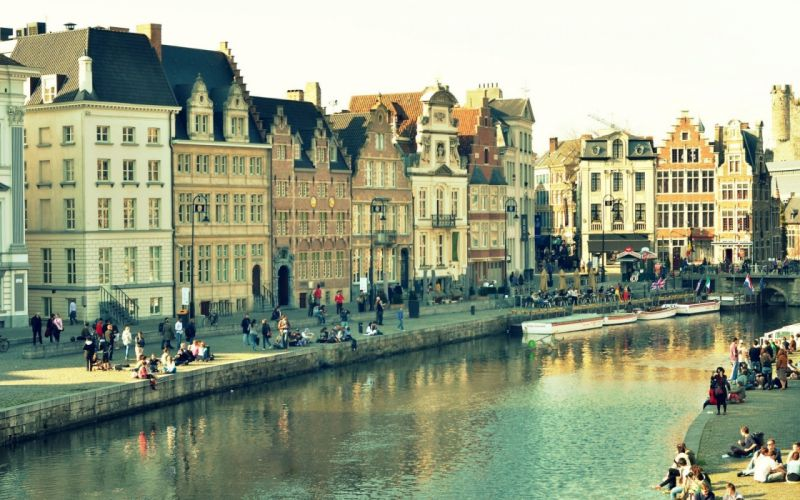 Ghent Belgium city houses buildings water reflection bridge canal window people wallpaper