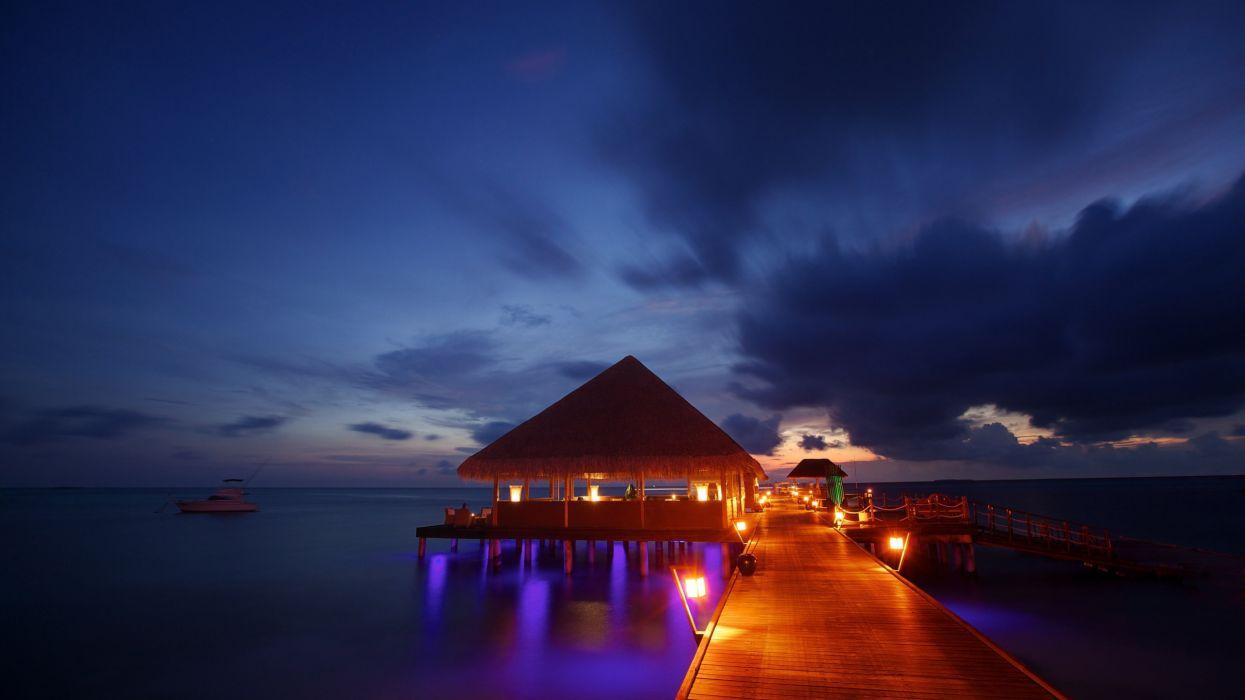 night lights Maldives tropical beach bungalow ocean sea sunset reflection wallpaper