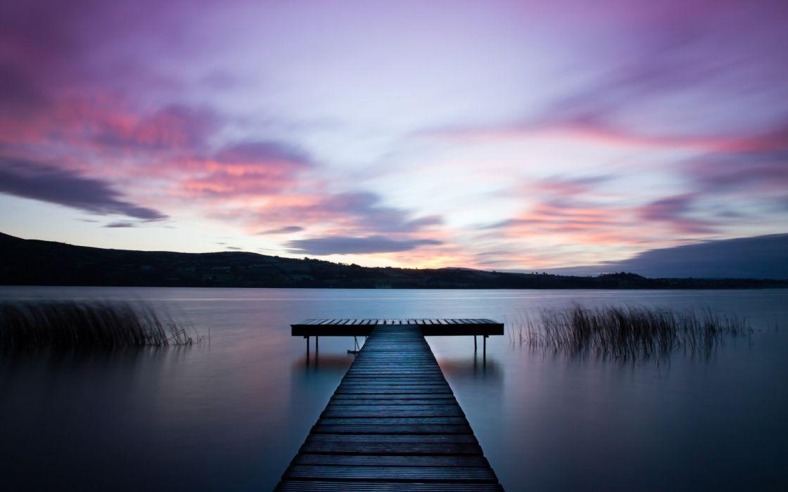river beach water surface grass wooden bridge night purple sky clouds wallpaper
