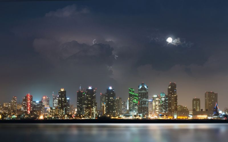 San Diego city night river water lights moon clouds thunder lightning skyscrapers wallpaper