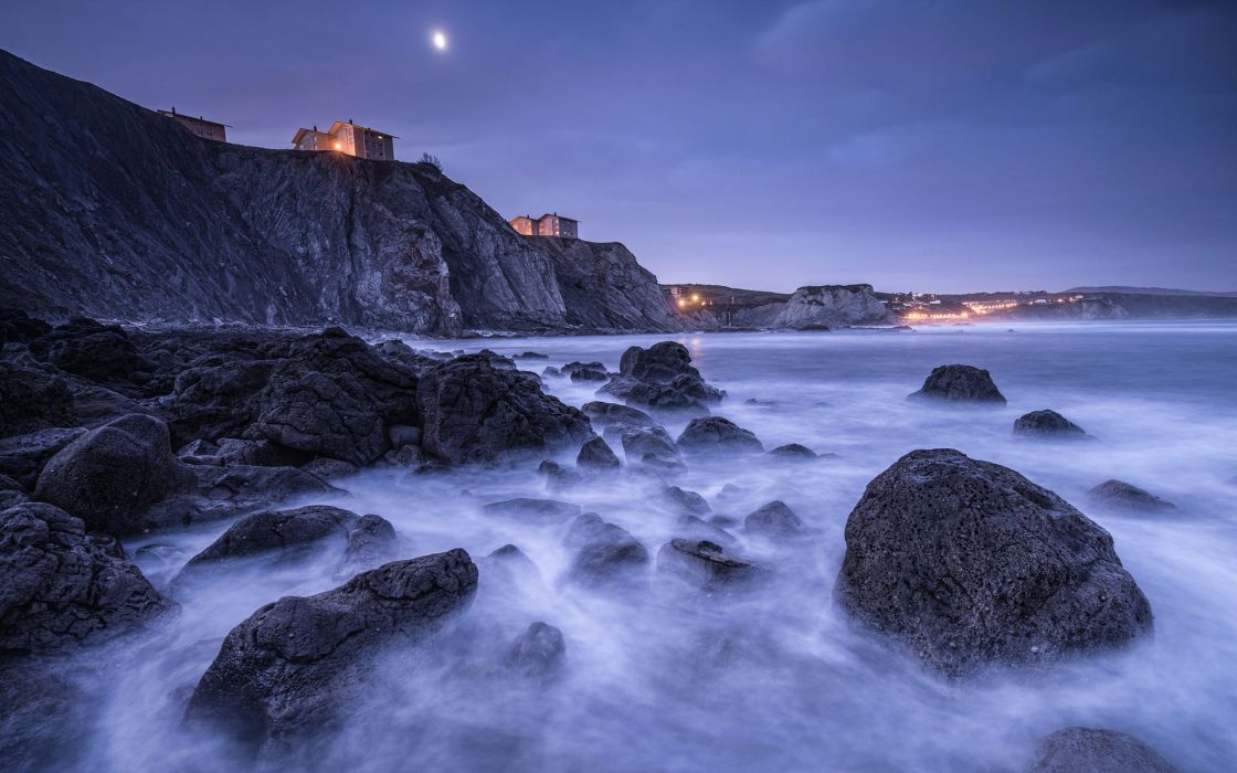 Spain Bay of Biscay beach stones rocks houses lights lighting night moon blue sky wallpaper