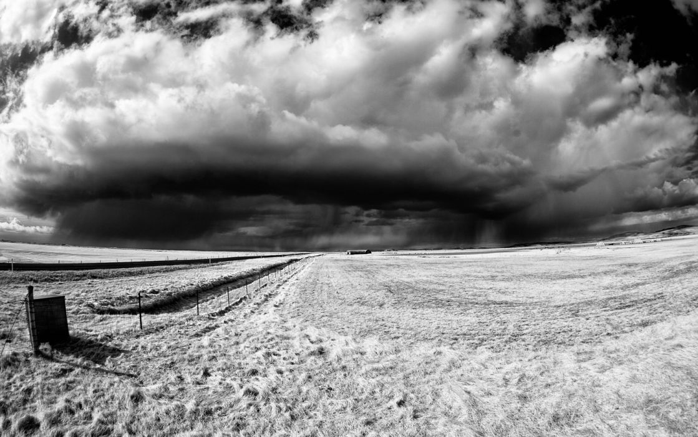 BW Storm Clouds Field wallpaper
