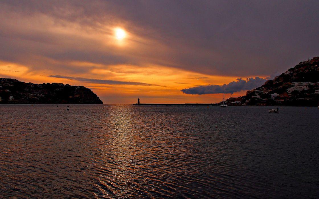 sea bay lighthouse mountains sunset clouds clouds sun wallpaper