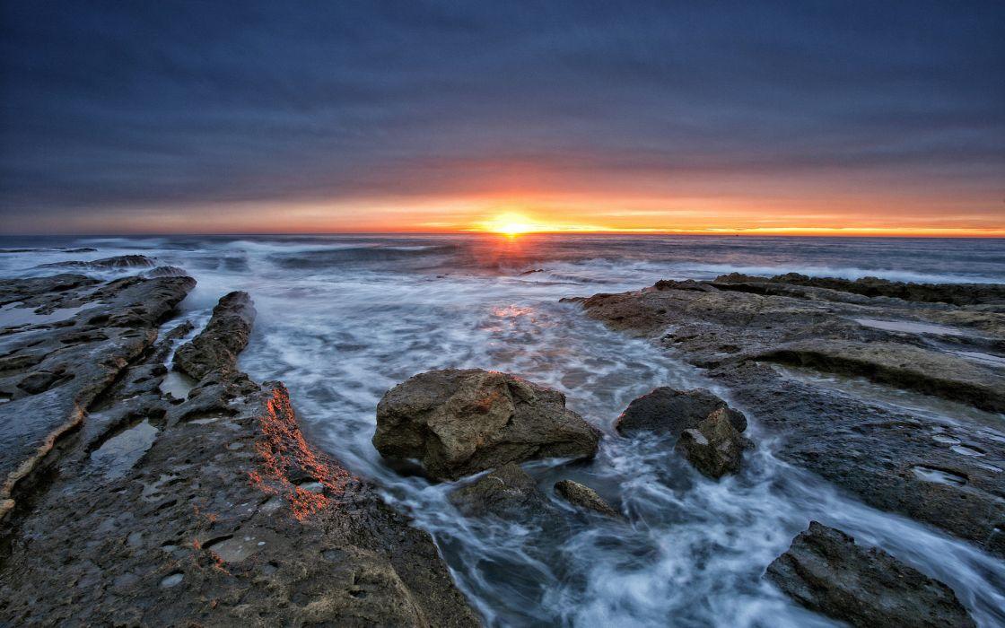 sea shore rocky horizon sun sunset reflection wallpaper
