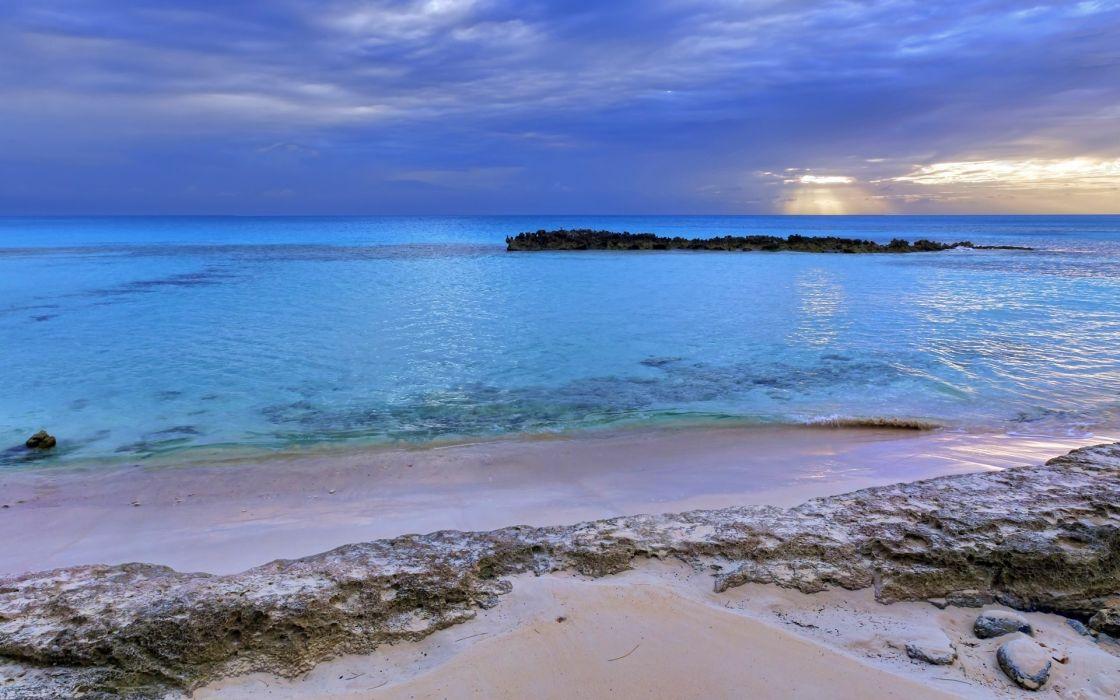 Sea  sand  clouds  rocks  sunset wallpaper