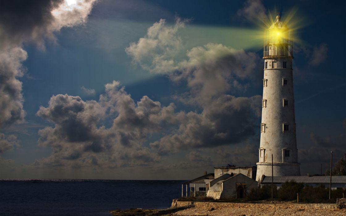 lighthouse ocean sea light sky clouds wallpaper