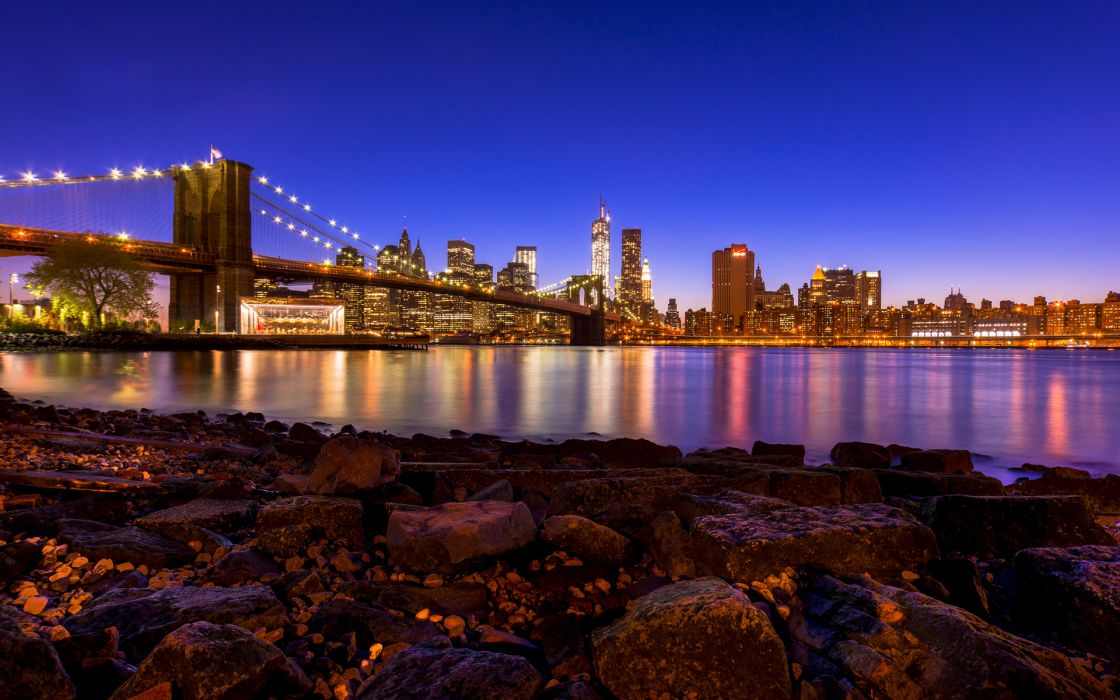 Brooklyn Bridge Bridge New York Buildings Skyscrapers Lights River Rocks Stones beaches reflection wallpaper