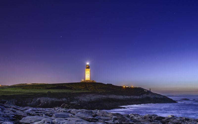 Lighthouse Night Light Coast beaches ocean sea wallpaper