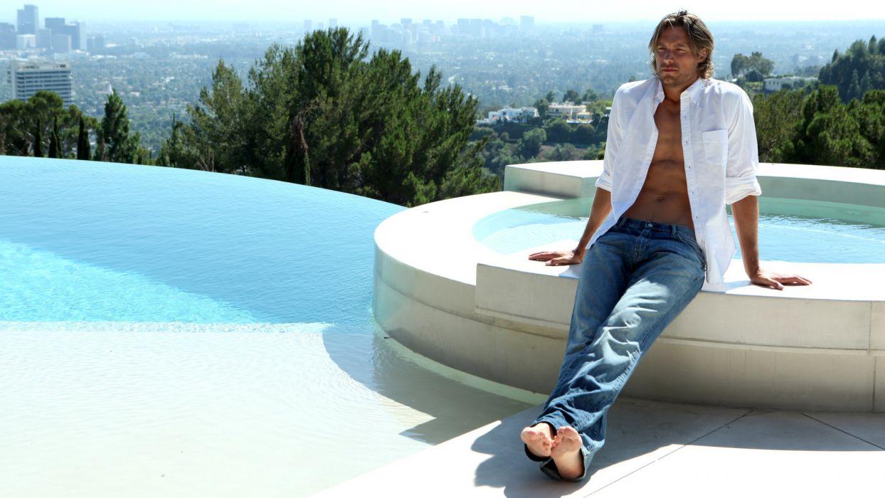 Gabriel Aubry man shirt jeans pool wallpaper