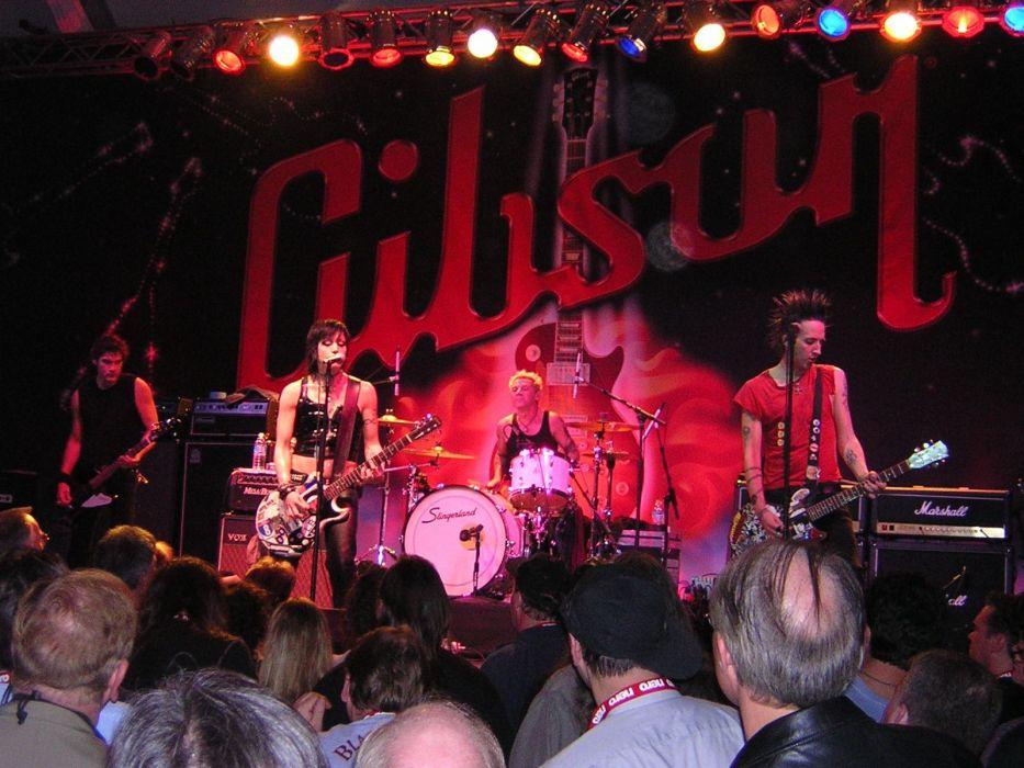 JOAN JETT hard rock singer band bands group groups girl girls women guitar guitars concert concerts  d wallpaper