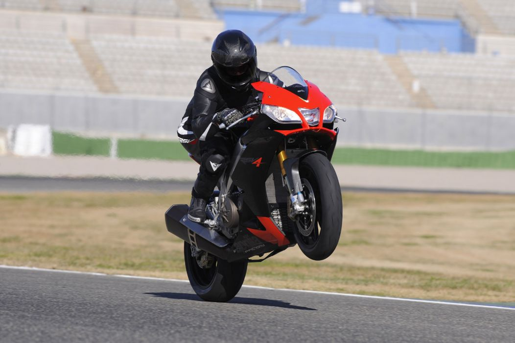 2010 Aprilia RSV4 Factory wheelie wallpaper