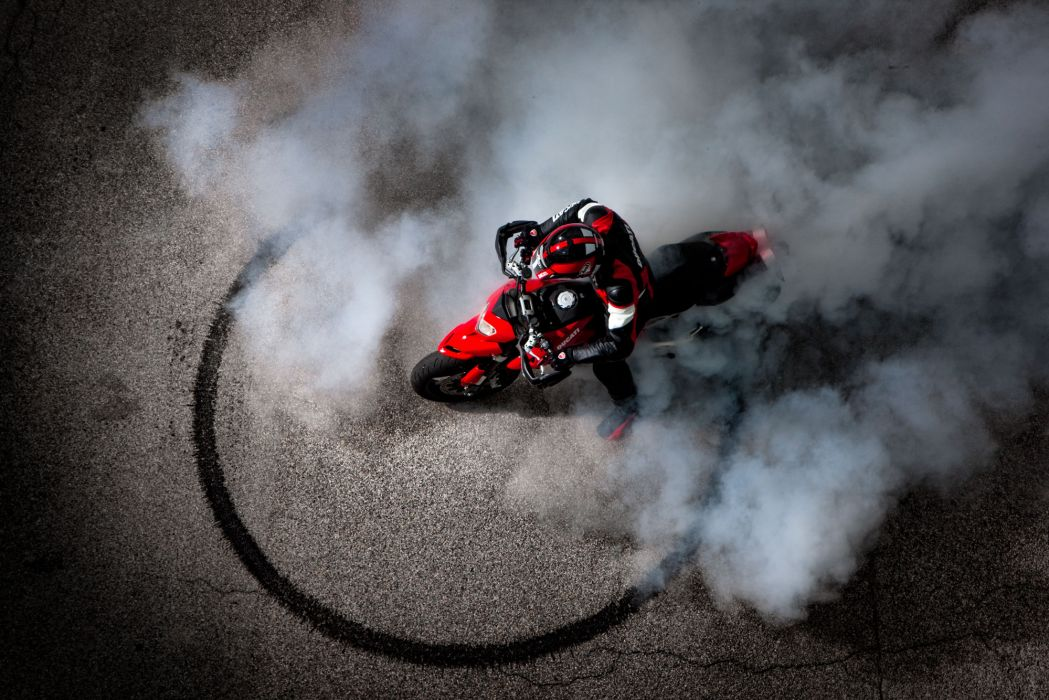 2012 Ducati Hypermotard 1100 EVO burnout smoke wallpaper