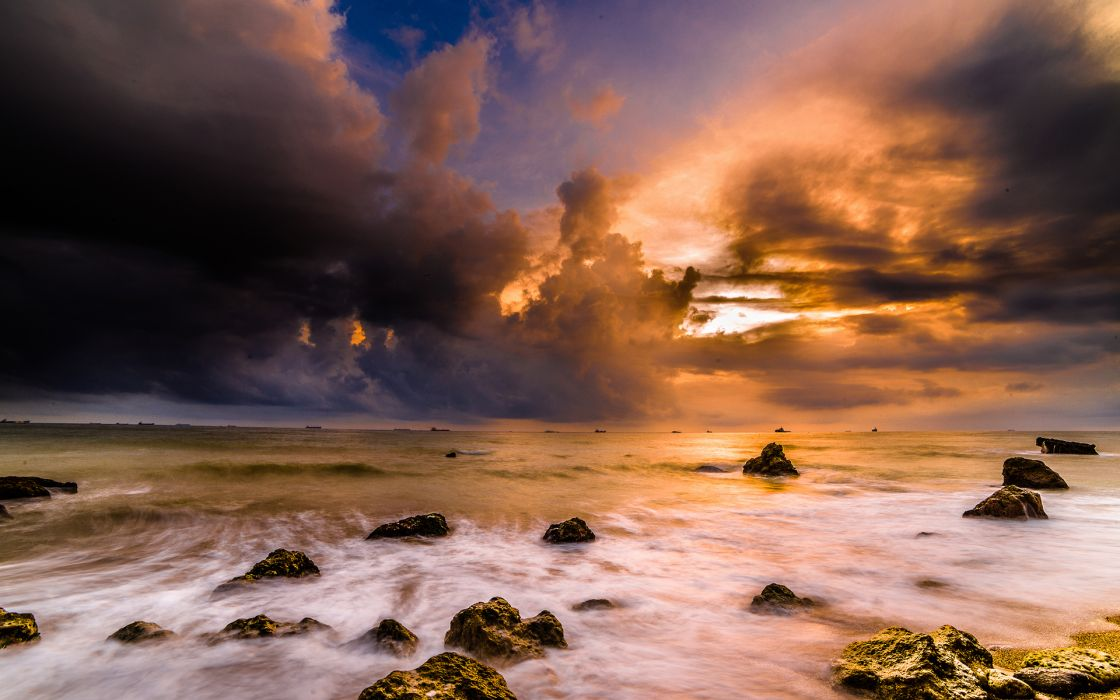 Clouds Ocean Rocks Stones sunset wallpaper