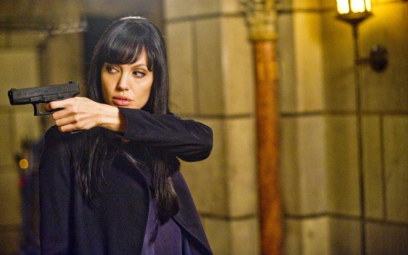 SALT Angelina Jolie actress brunette girl girls women female females movie movies weapon weapons gun guns pistol wallpaper