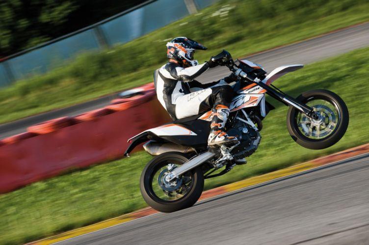2010 KTM 690 SMC wheelie wallpaper