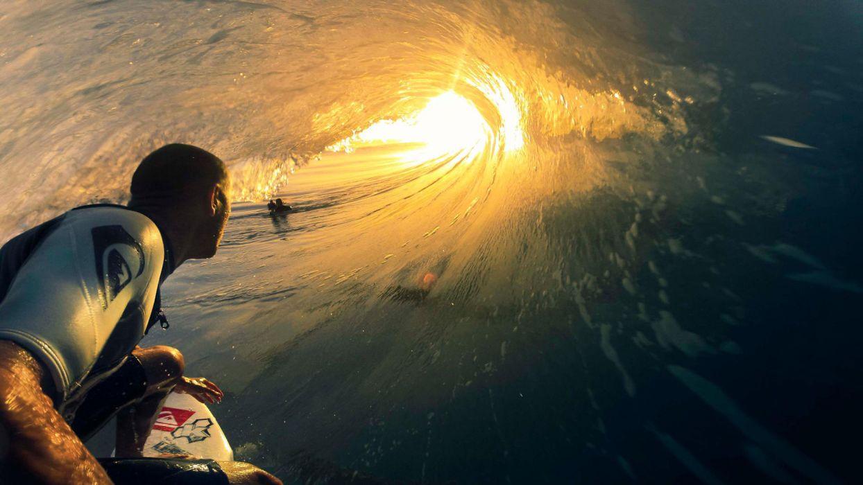 Surfer Surfing Wave Ocean Sunset Sunlight wallpaper
