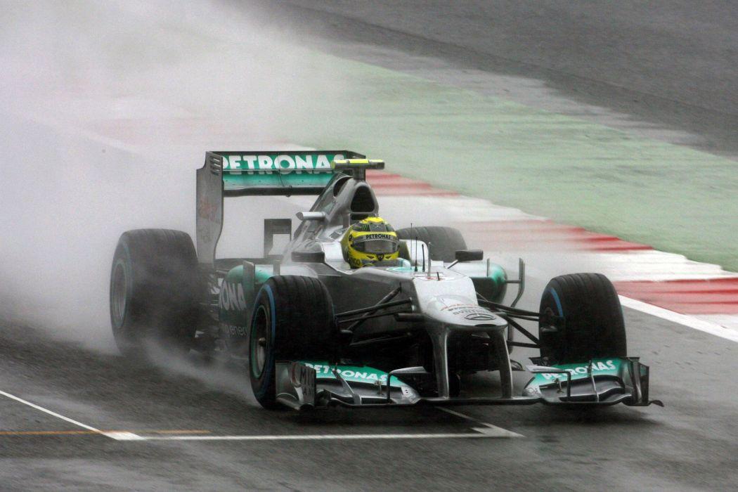 2012 formula one formula-1 race racing f-1 rain wallpaper