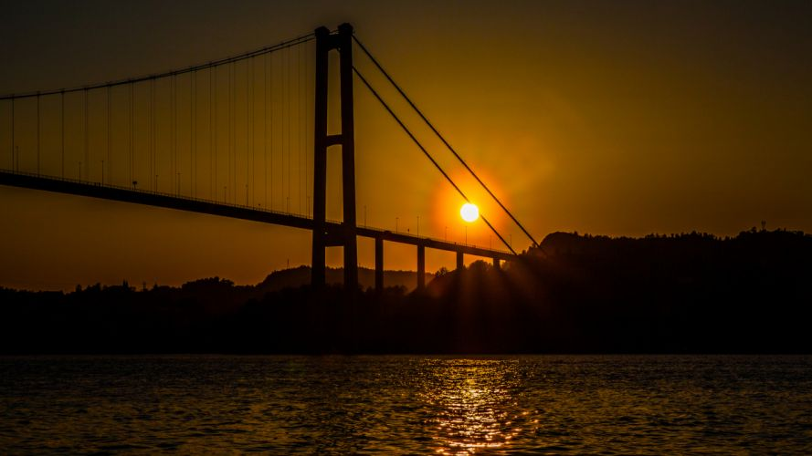 Bridge Sunlight Ocean Silhouette wallpaper