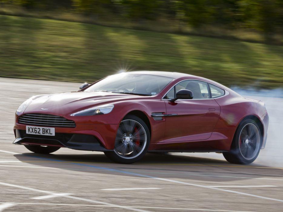2012 Aston Martin Vanquish UK sportcar burnout smoke drift  f wallpaper