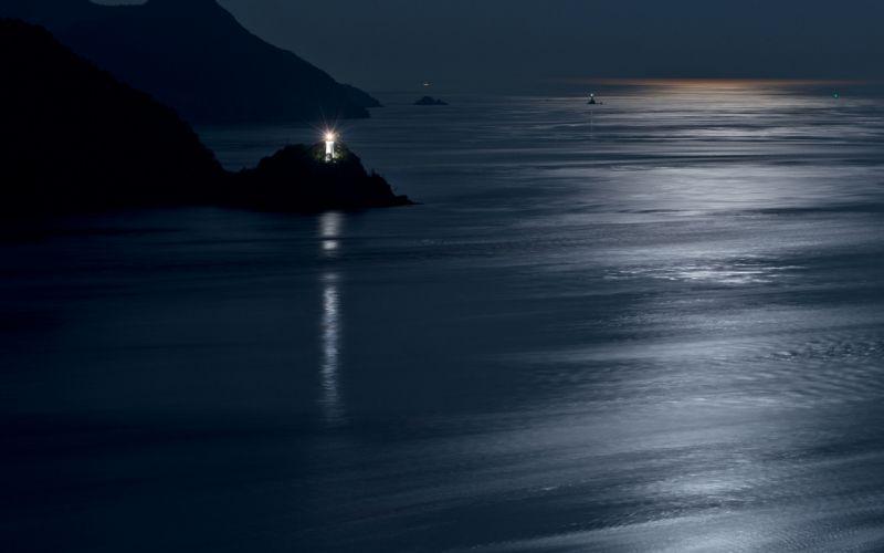 Lighthouse Coast night ocean sea reflection moon moonlight lights scenic shore mood wallpaper