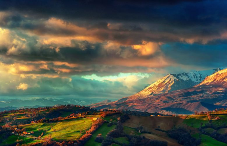 Italy the Apennines the mountain the mountain range Monti Sibillini spring March storm clouds the sky the valley fields houses wallpaper