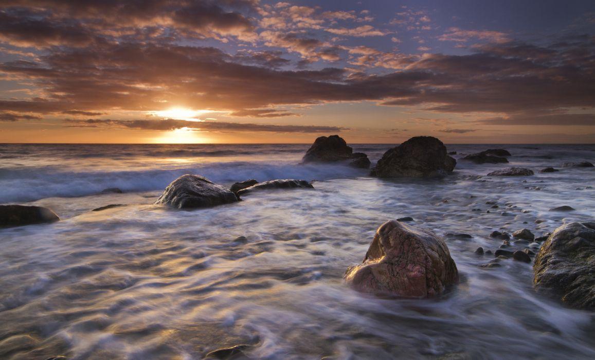 England sunset rocks sea ocean wallpaper