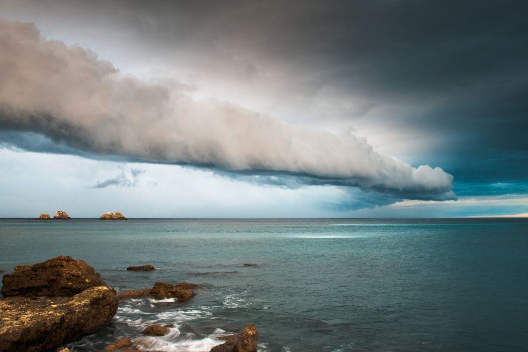 sea rocks sky clouds wallpaper