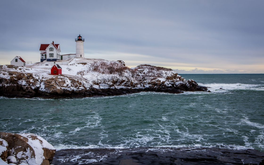 winter the sea the rocky coast the lighthouse landscape wallpaper