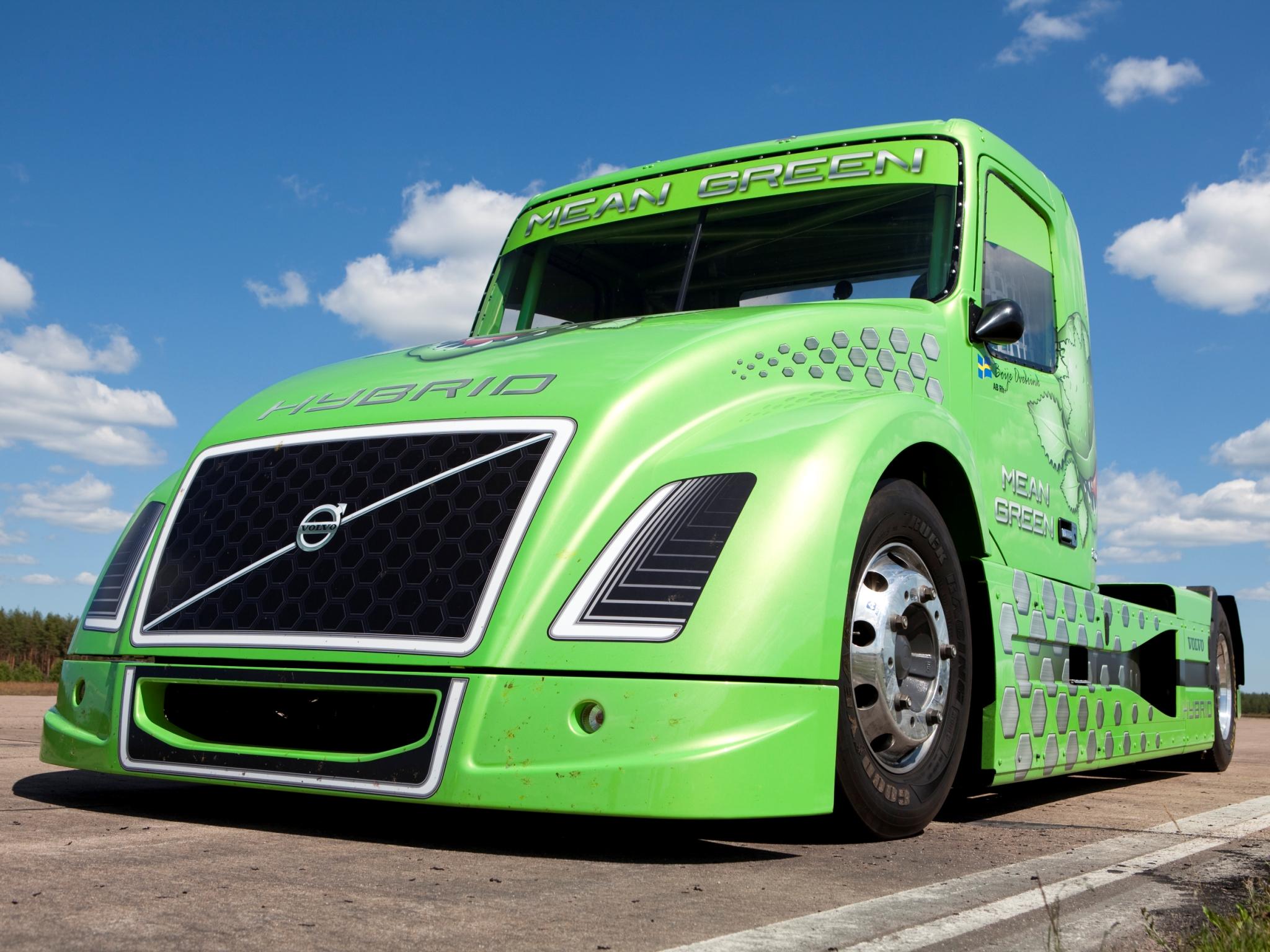 2010 volvo vnl mean green hybrid truck semi tractor rig rigs g wallpaper 2048x1536 120308 - Volvo vnl wallpaper ...