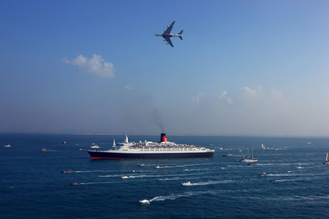 Queen Elizabeth 2 Emirates Airline Airbus A380 Aircraft Airliner boats Navy Sea Lots Security Military liner ship Day Passenger Side View Sky wallpaper