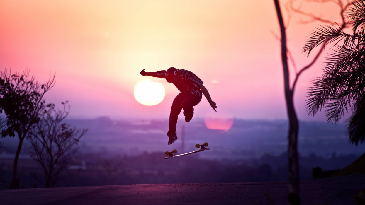 Skateboard Skateboarding Jump Stop Action Sunset wallpaper