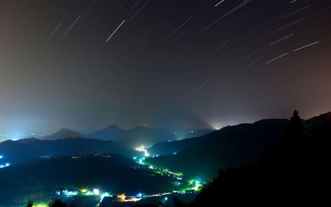 night sky lights trees hills wallpaper