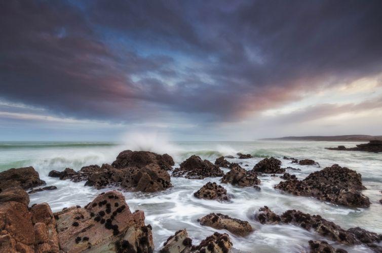 Sea sky clouds beach rocks stones ocean wallpaper