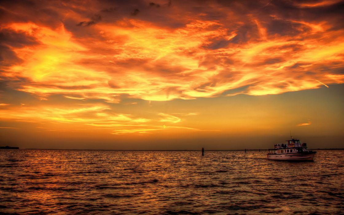 sunset  sea  ship ocean sky clouds boat wallpaper