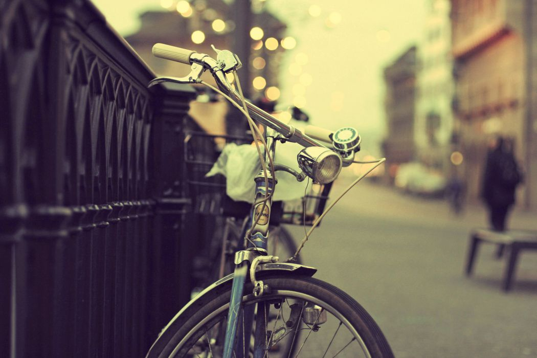 bicycle city street fence people bokeh lights wallpaper