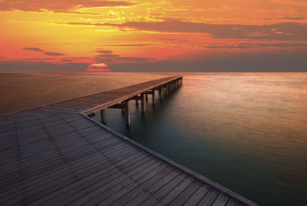 landscape sea river ocean water pier marina sunset sun clouds sky wallpaper