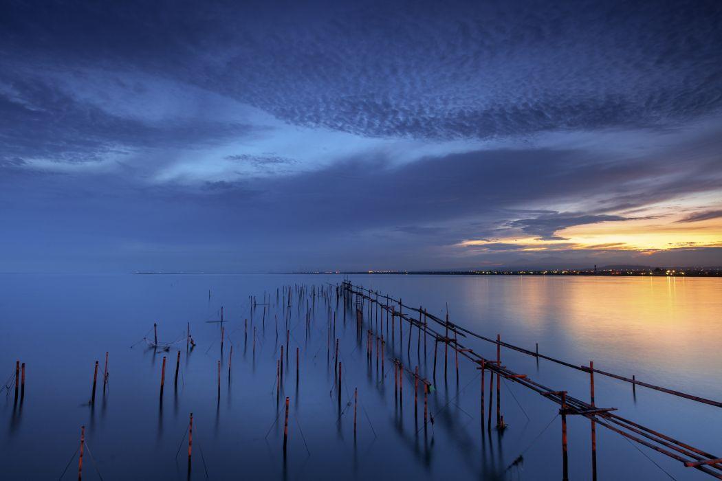 sea calm tranquility taiwan ocean sunset sky reflection
