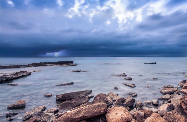 blue ocean rocks sky beach sea lightning wallpaper