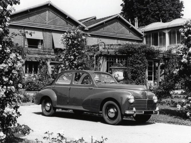 1949 Peugeot 203 Decouvrable retro wallpaper