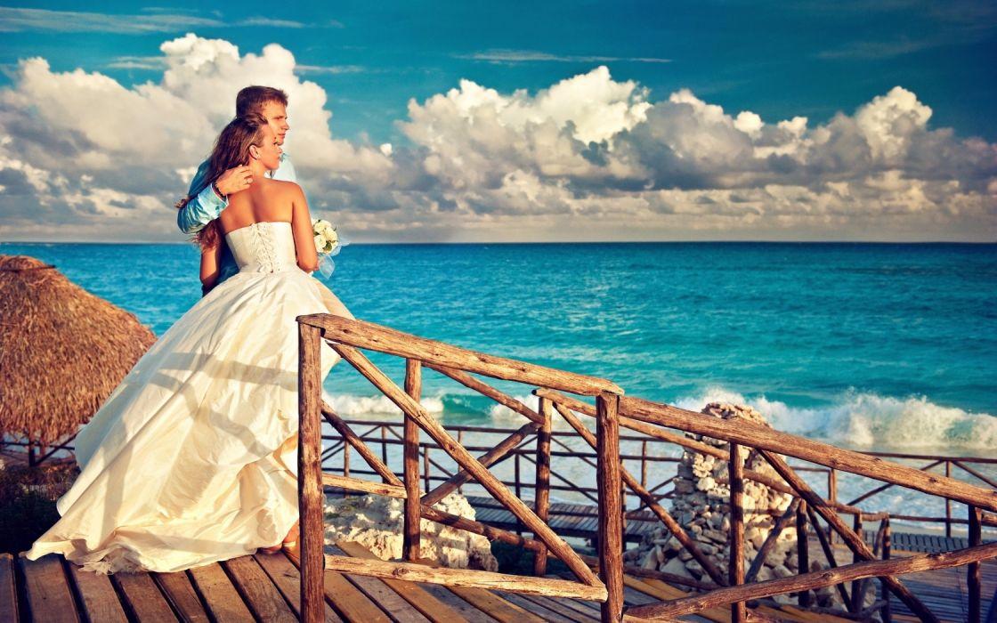 Girl Bride Groom Shore Ocean Clouds wallpaper