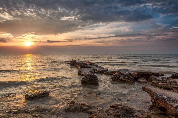 landscape sunrise sun clouds sky lake rocks Lake Michigan Wisconsin wallpaper