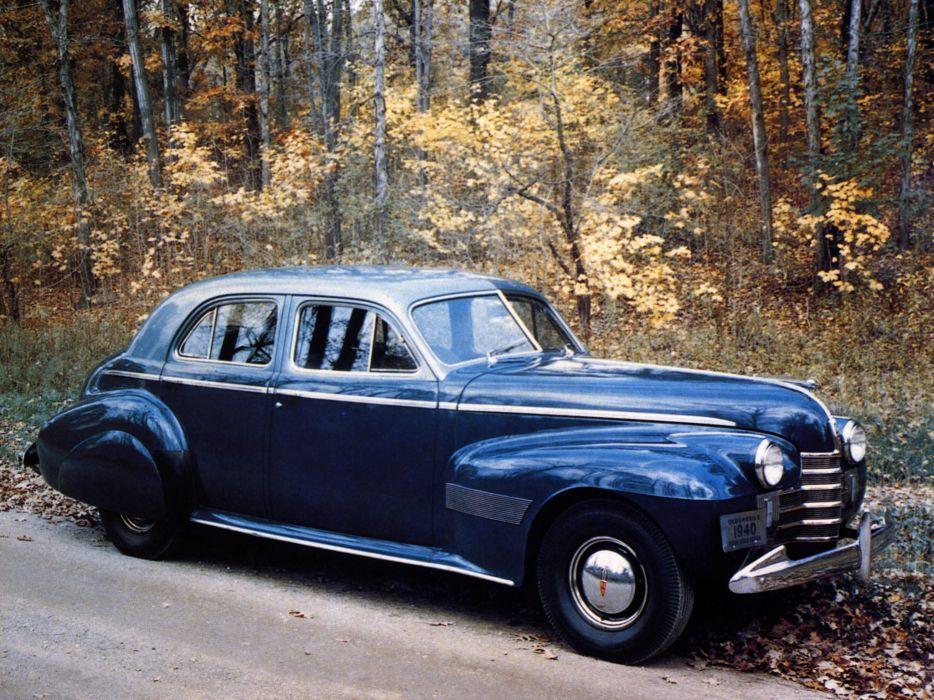 1940 Oldsmobile Custom Cruiser (3919) retro wallpaper