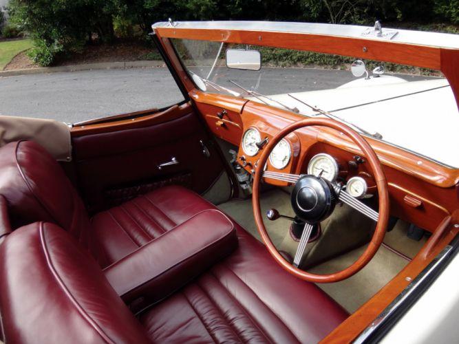1948 Triumph 2000 Roadster retro sportscar convertible interior h wallpaper