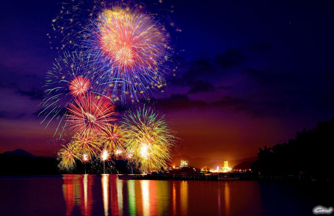 fireworks city lights night lake wallpaper