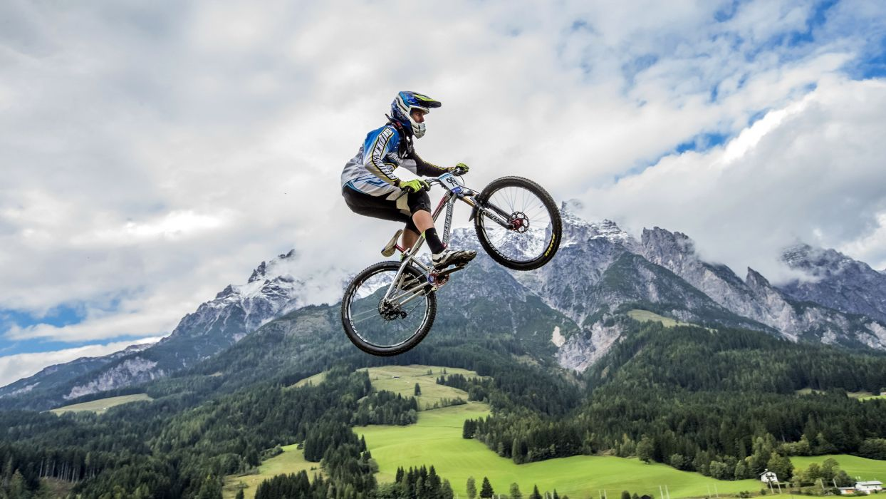 Mountains Bicycle Jump Sport Nature wallpaper
