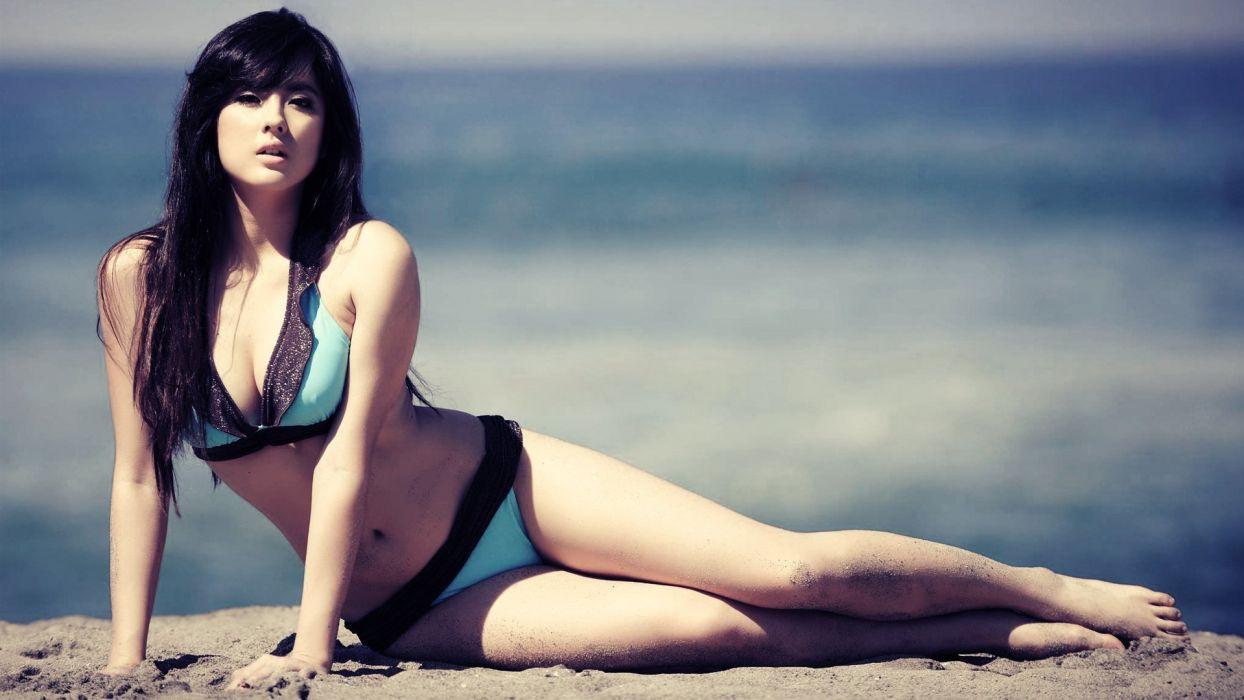 girl asian beach sand black hair posture eye sun swimsuit background wallpaper