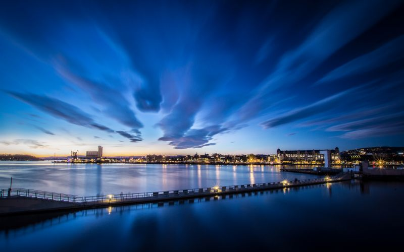 River Buildings Clouds Sunset reflection wallpaper