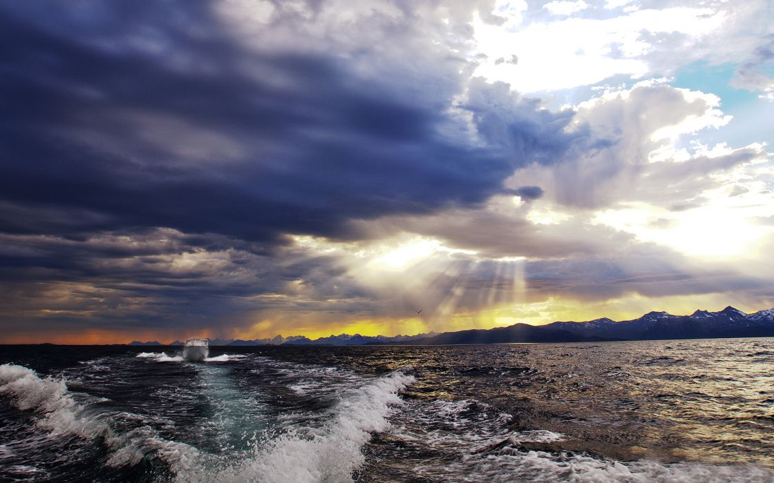 Clouds Ocean Sunlight Boat sky clouds wallpaper