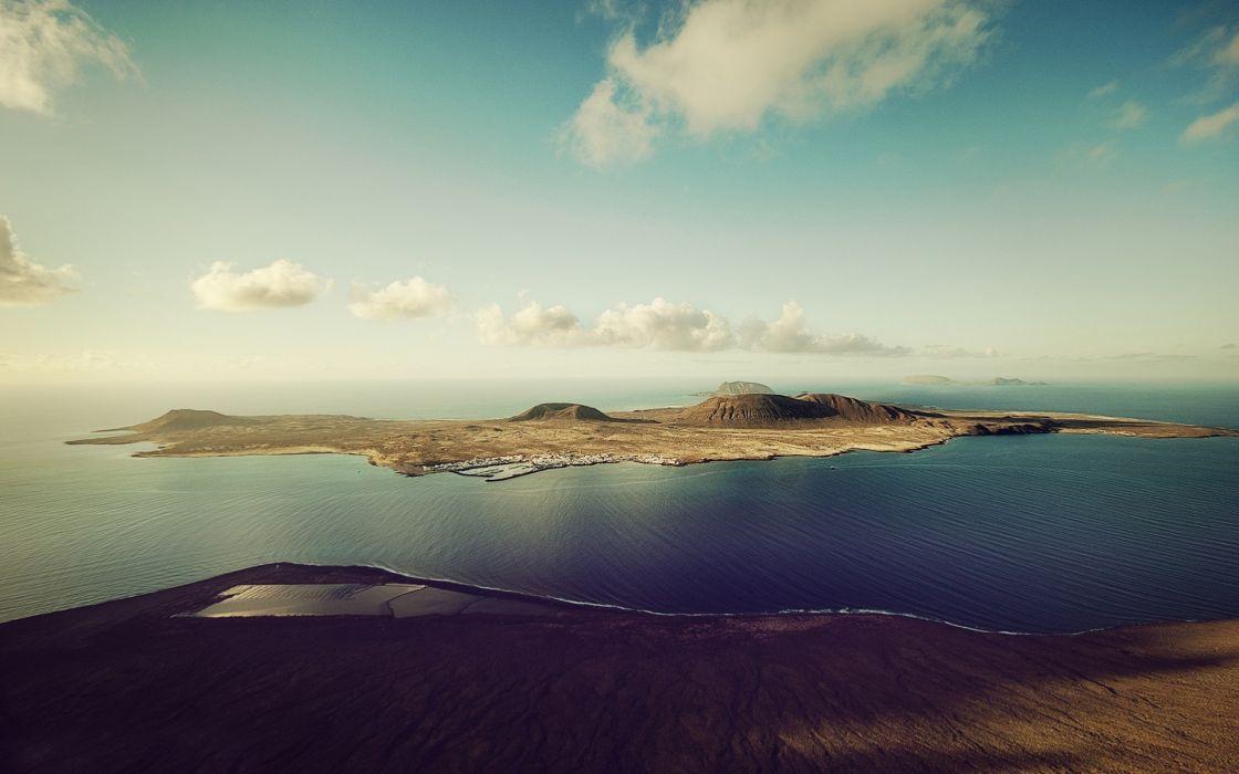 mountains ocean clouds landscapes islands Spain skyscapes La Graciosa Canary Islands wallpaper